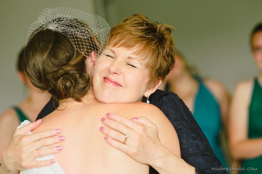 mother of bride hugging bride