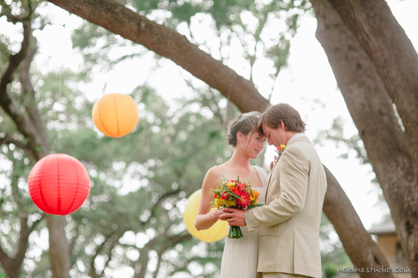 bride and groom and colorful balloons