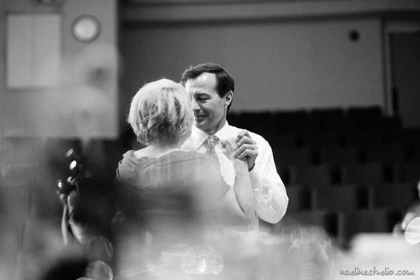 father and mother of groom dancing