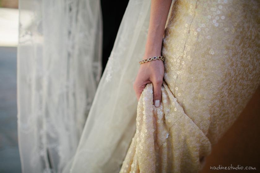 bride holding er wedding dress