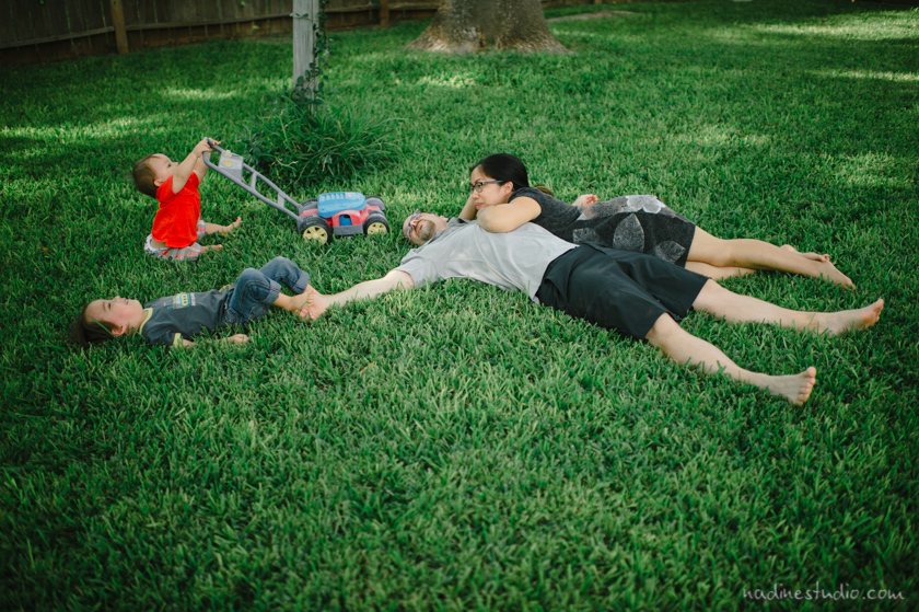 family lounging in the grass
