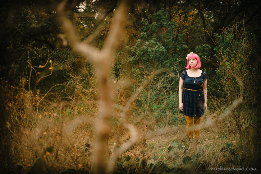pink haired girl in a park