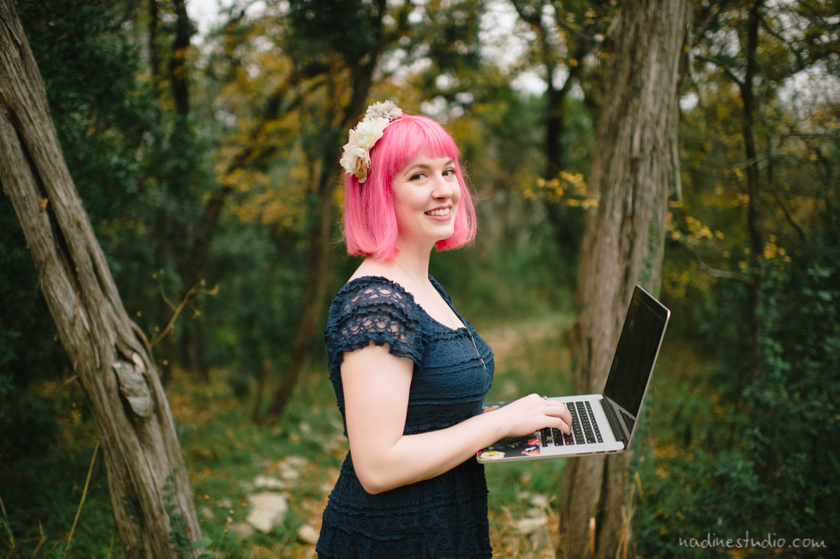 girl with a computer macbook in the forest