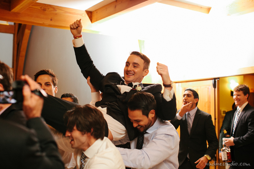 groom being carried by groomsmen