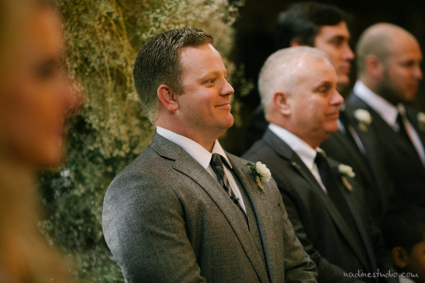 groom seeing bride for the first time walking down the aisle