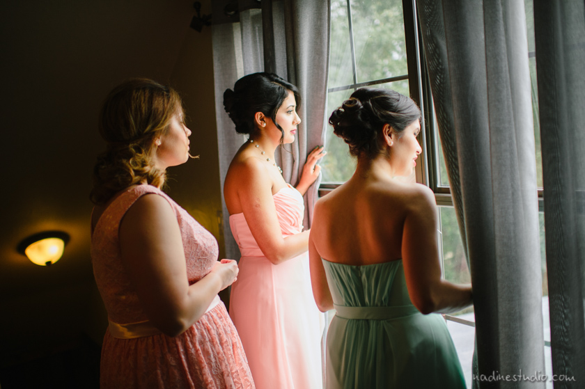 bridesmaid looking out the window