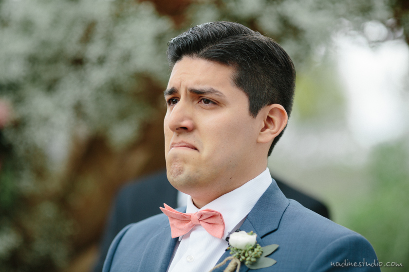 groom crying seeing bride for the first time at a wedding ceremony