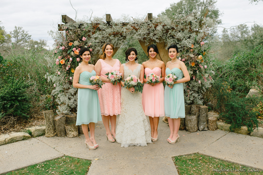 bridesmaids in pastel dresses