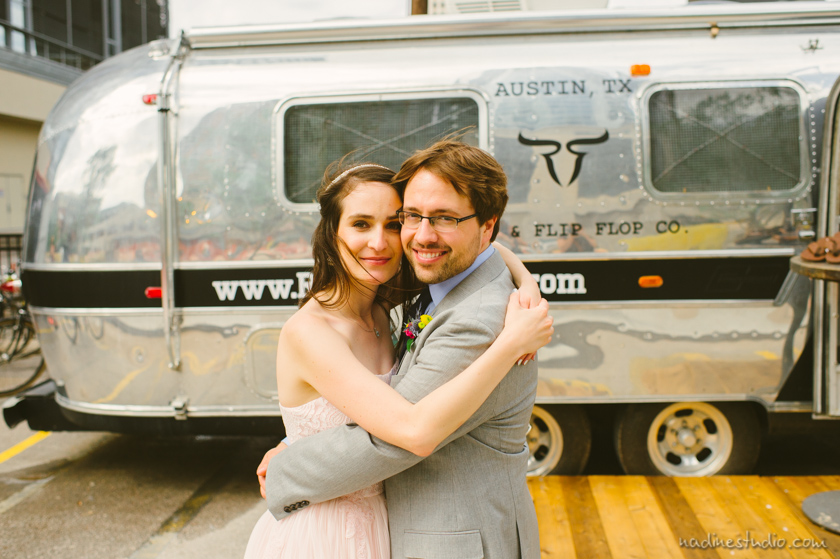 rickshaw boots downtown austin airstream trailer, wedding couple in front