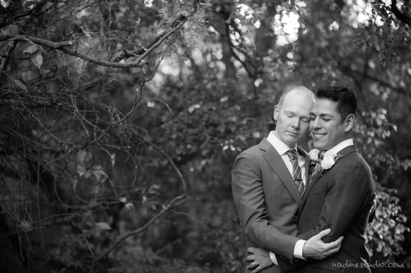 black and white image of a loving gay couple