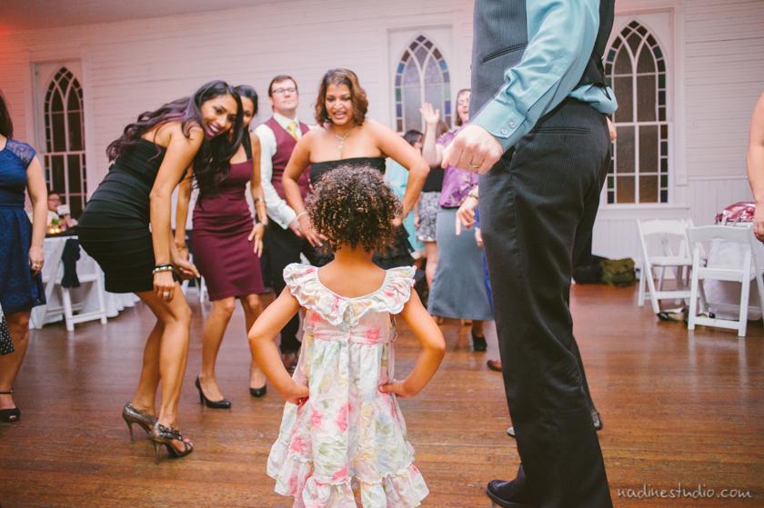 girl glaring at dancers