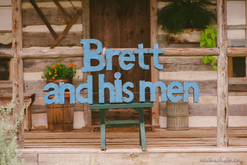 wooden sign announcing groomsmen