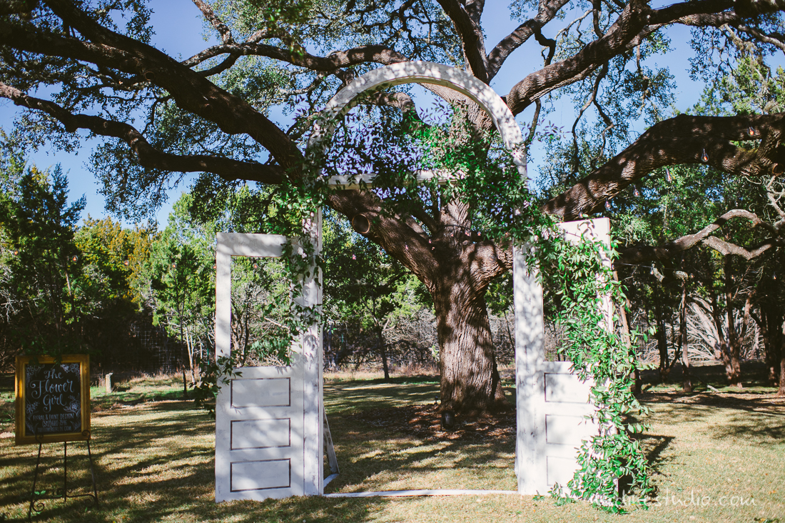 ceremony at rustic ranch two wooden doors with ivy