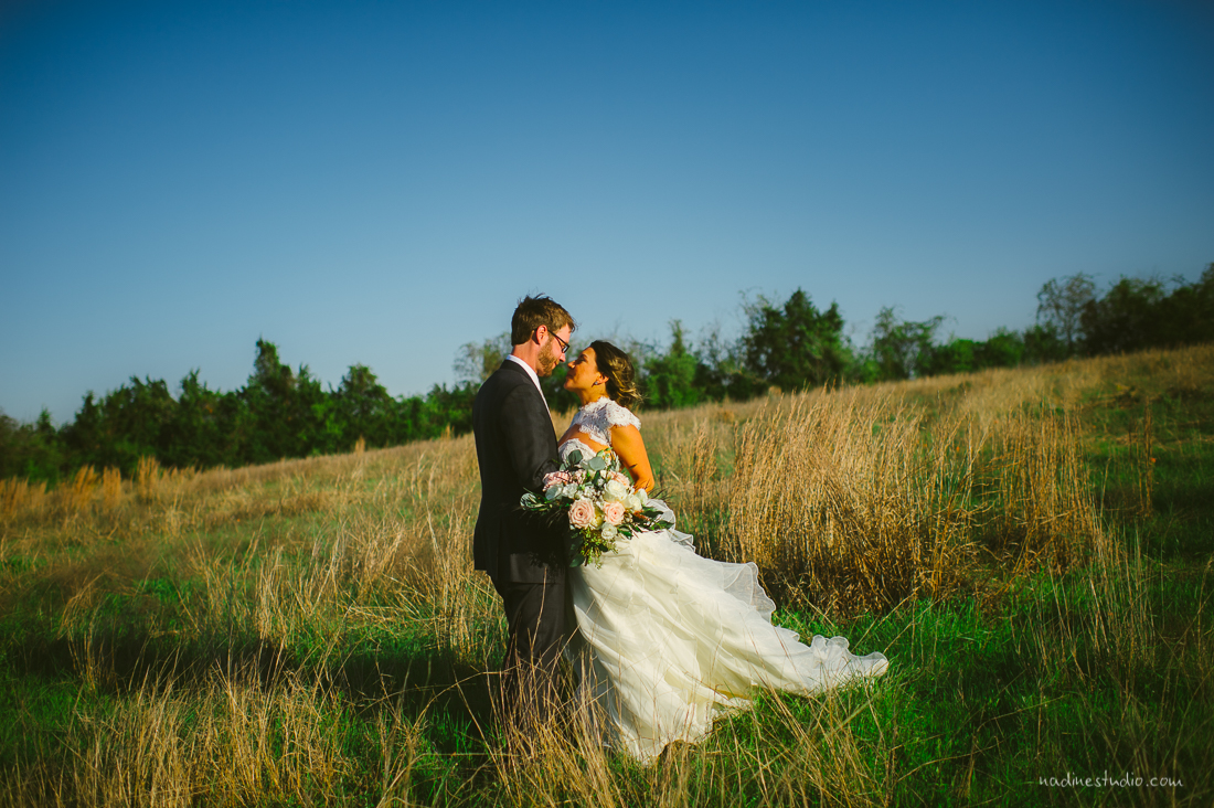 bride and groom in a field in round rock, tx