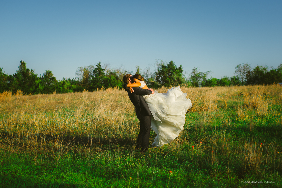 bride and groom in a field in brenham, tx