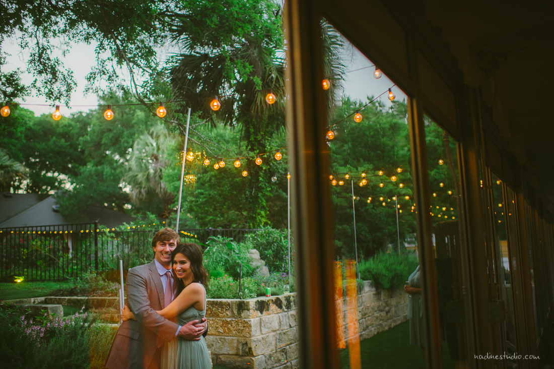 a couple take a moment to hug each other during a wedding reception