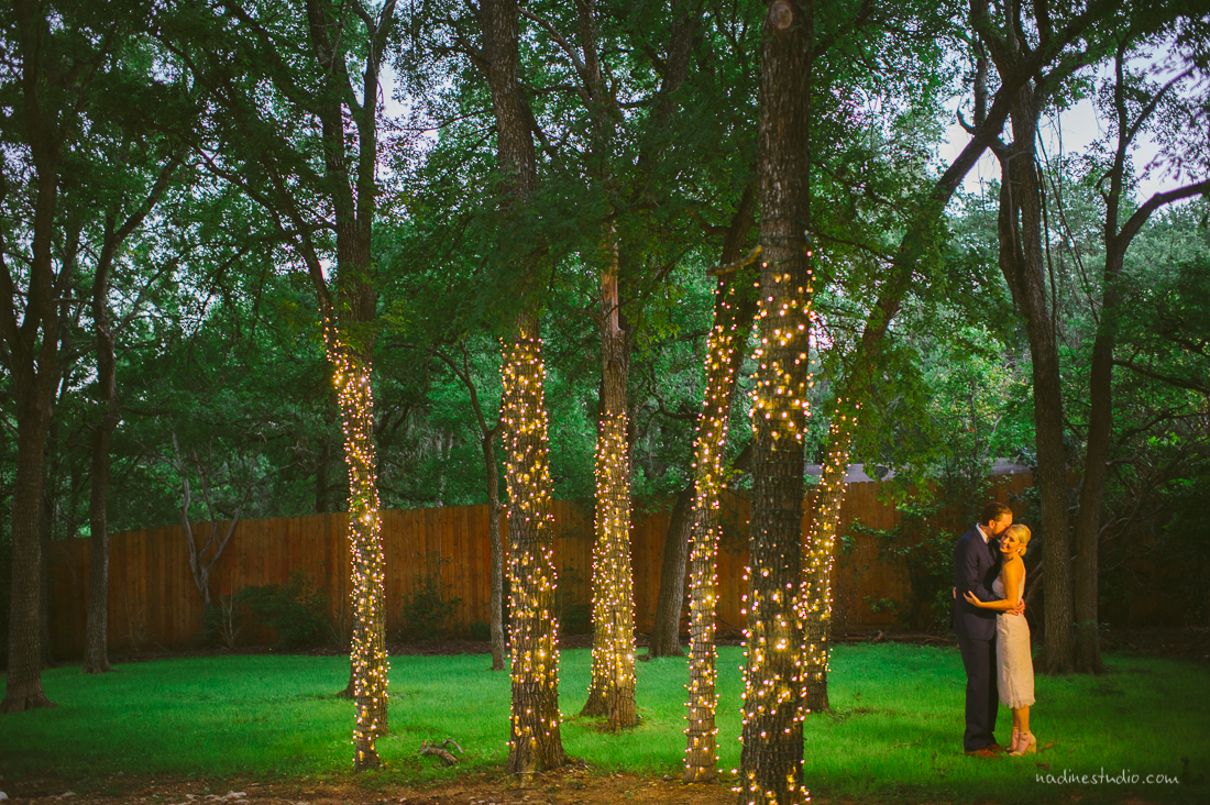 twinkle lights surrounding the couple in the hummingbird house