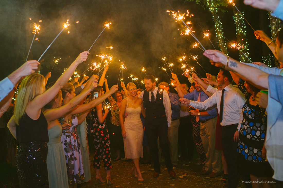 a classic sparkler exit framing the couple as they leave their wedding
