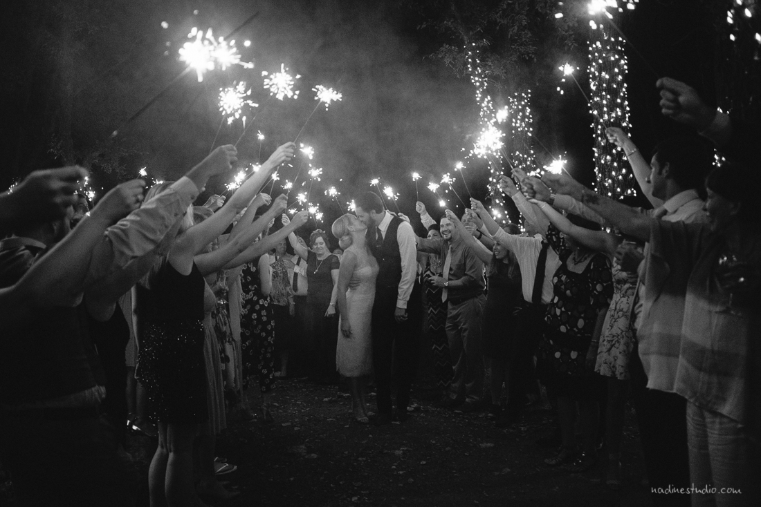 black and white shot of a sparkler exit