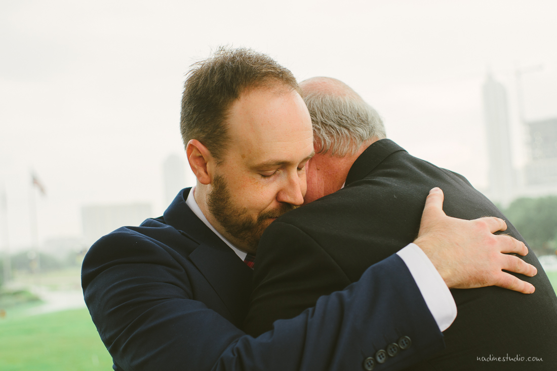 father and son during a wedding hugging