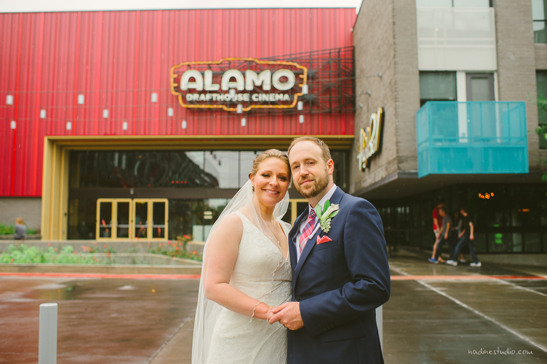 bride and groom in front of alamo drafthouse highball wedding