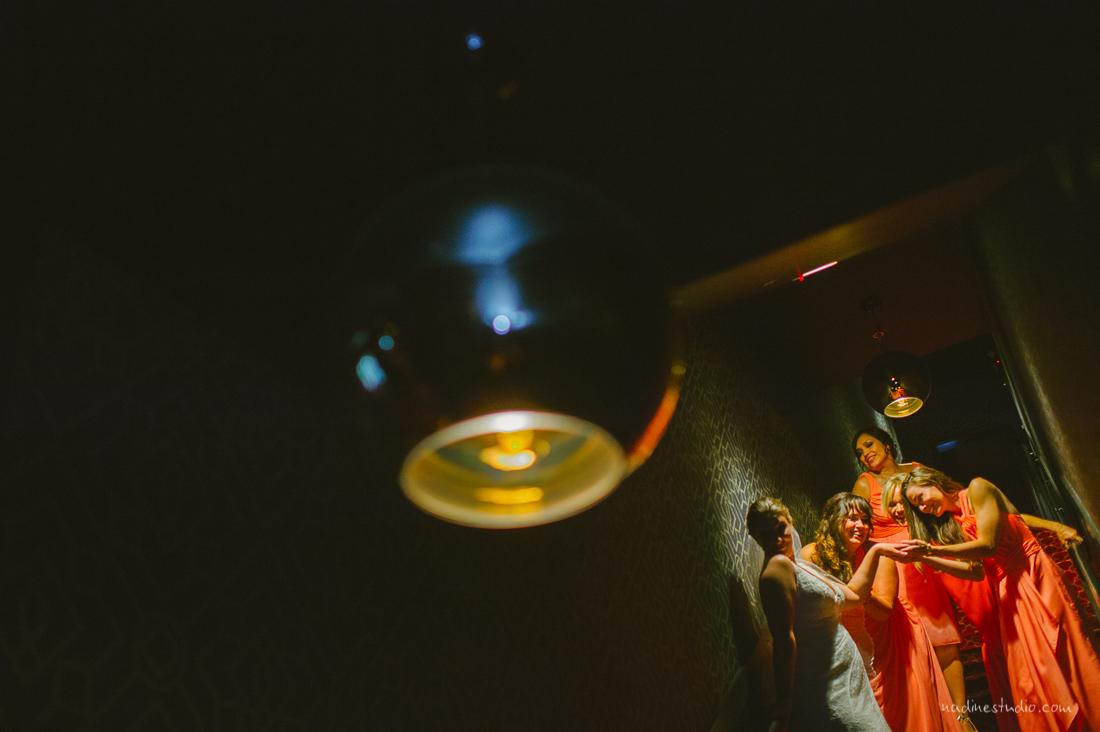bridesmaids looking at bridal ring