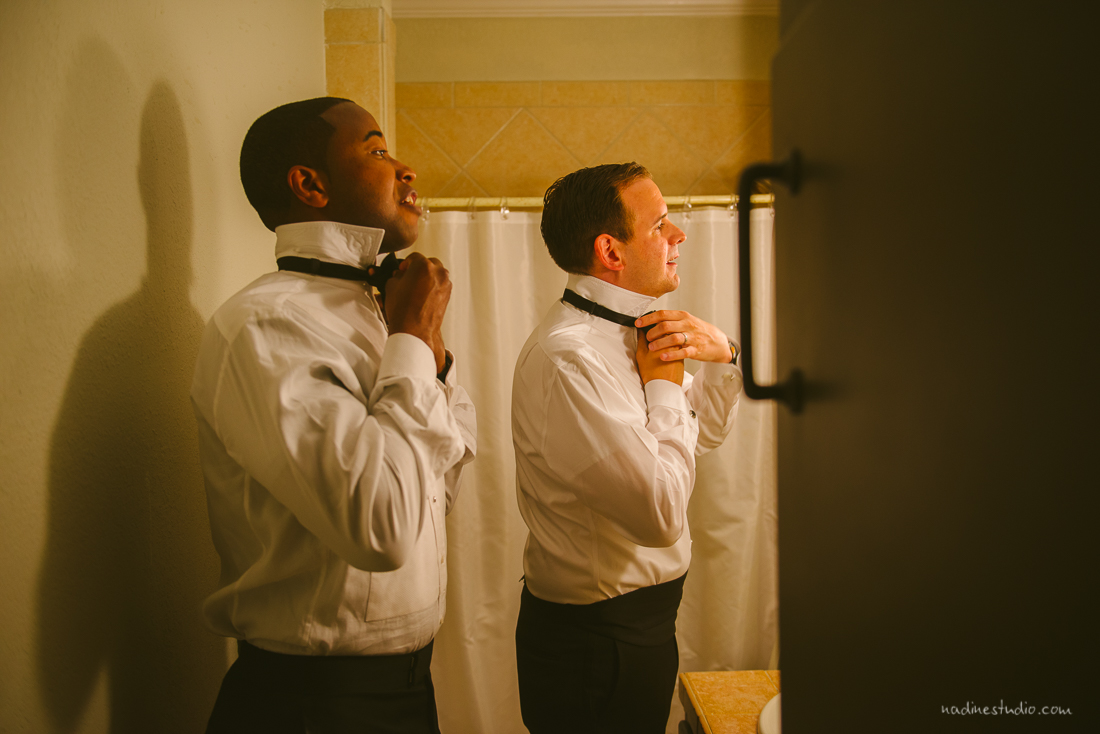 tying bowties during a wedding