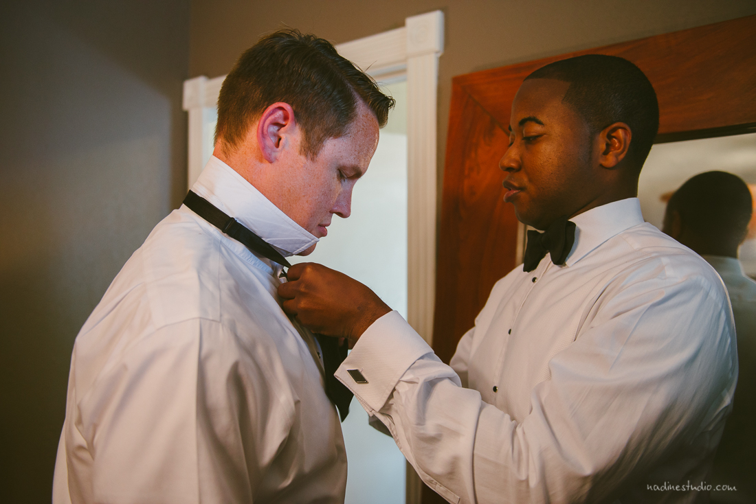 helping the groom get ready
