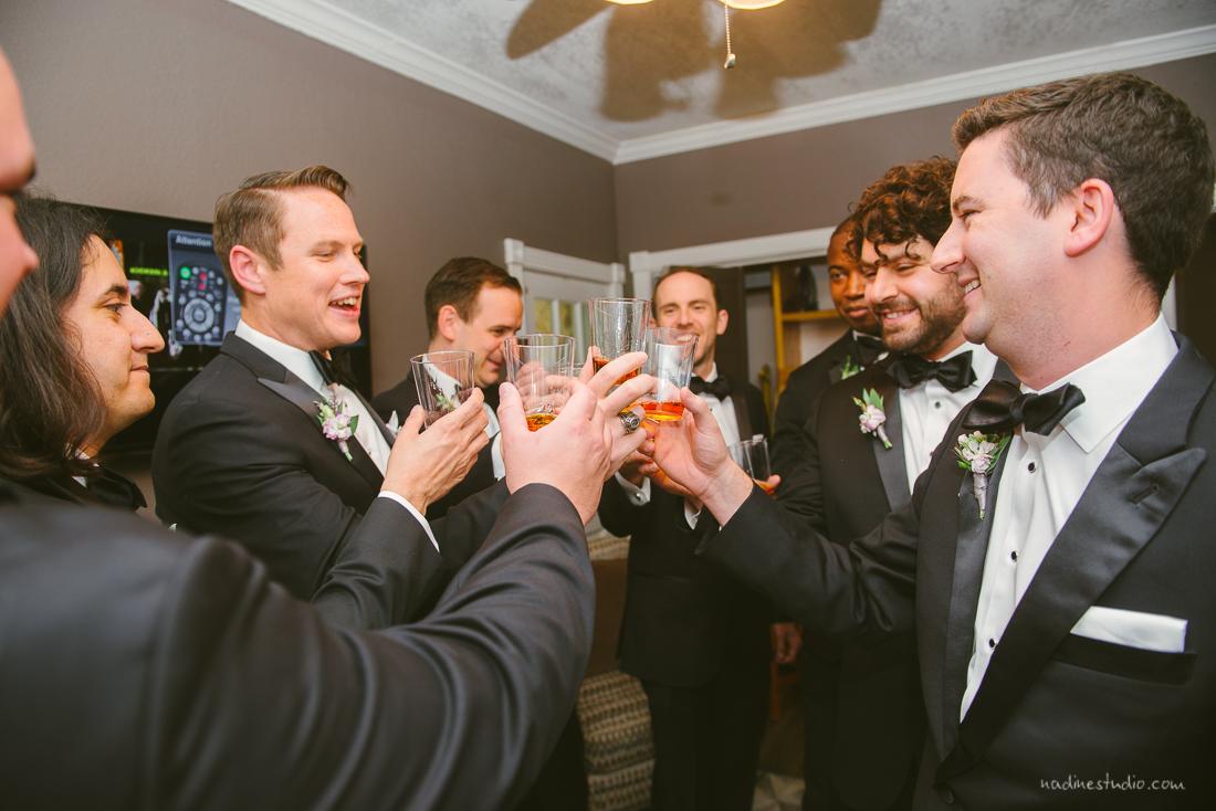 groomsmen cheering a toast