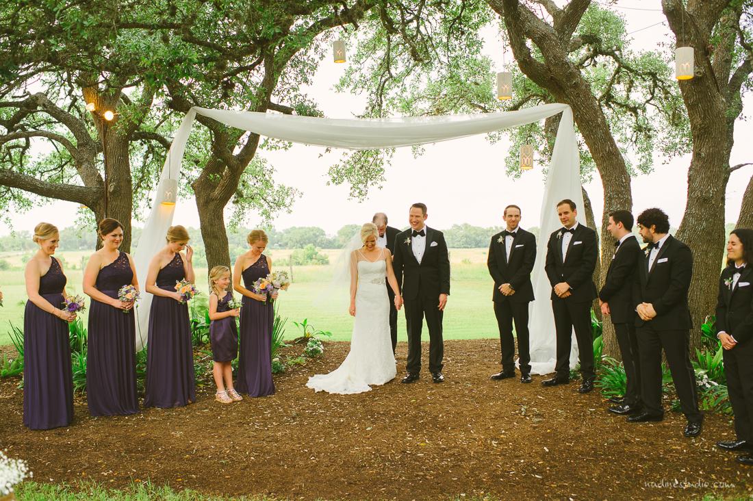 fabric canopy among oak trees ceremony