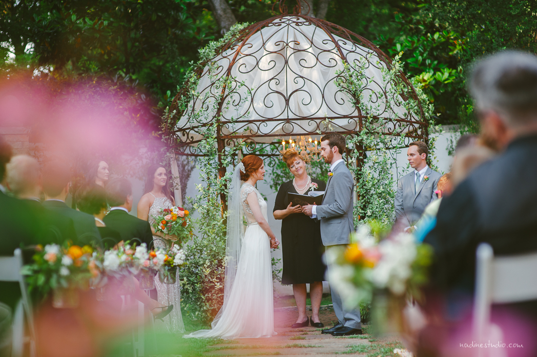 officiant and couple at hummingbird house