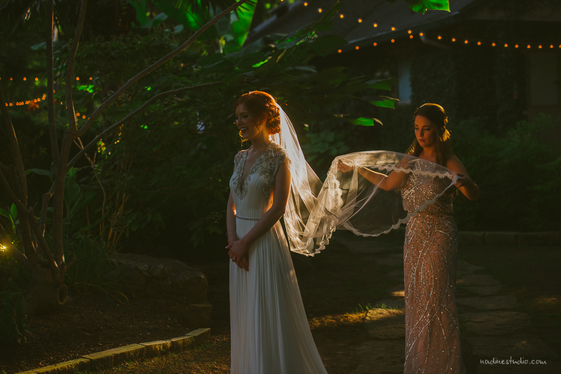 maid of honor helping bride during portraits