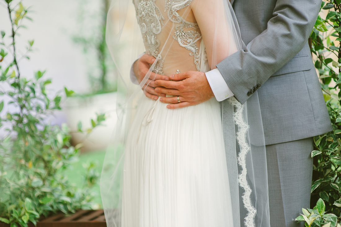 couple hugging with a long veil