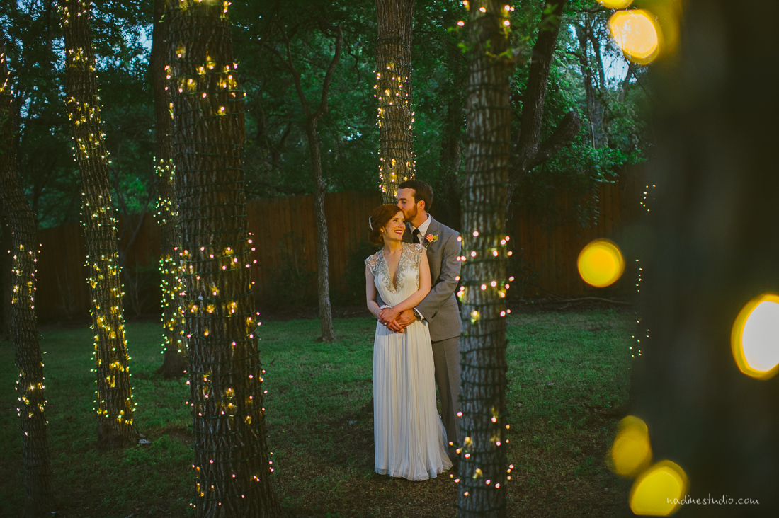 twinkle lights bride and groom portrait