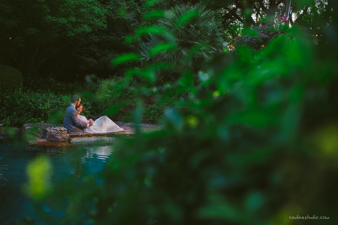 portraits by an emerald blue pool