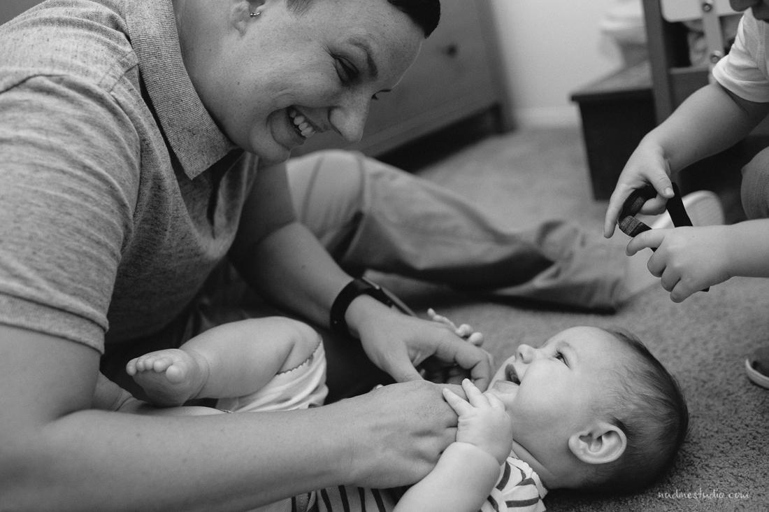 mama tickling child