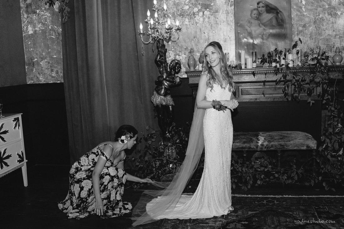 bridesmaid fixing bride