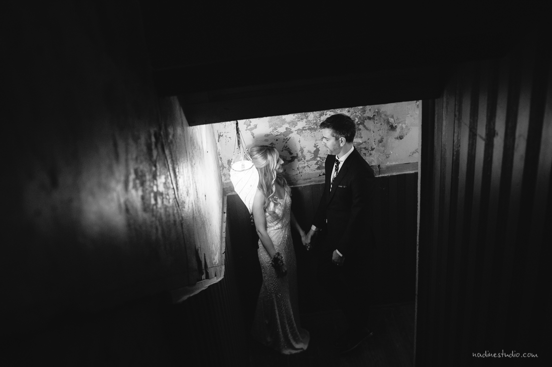 couple in a stairwell in black and white