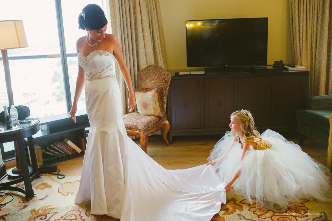 flowergirl helping bride