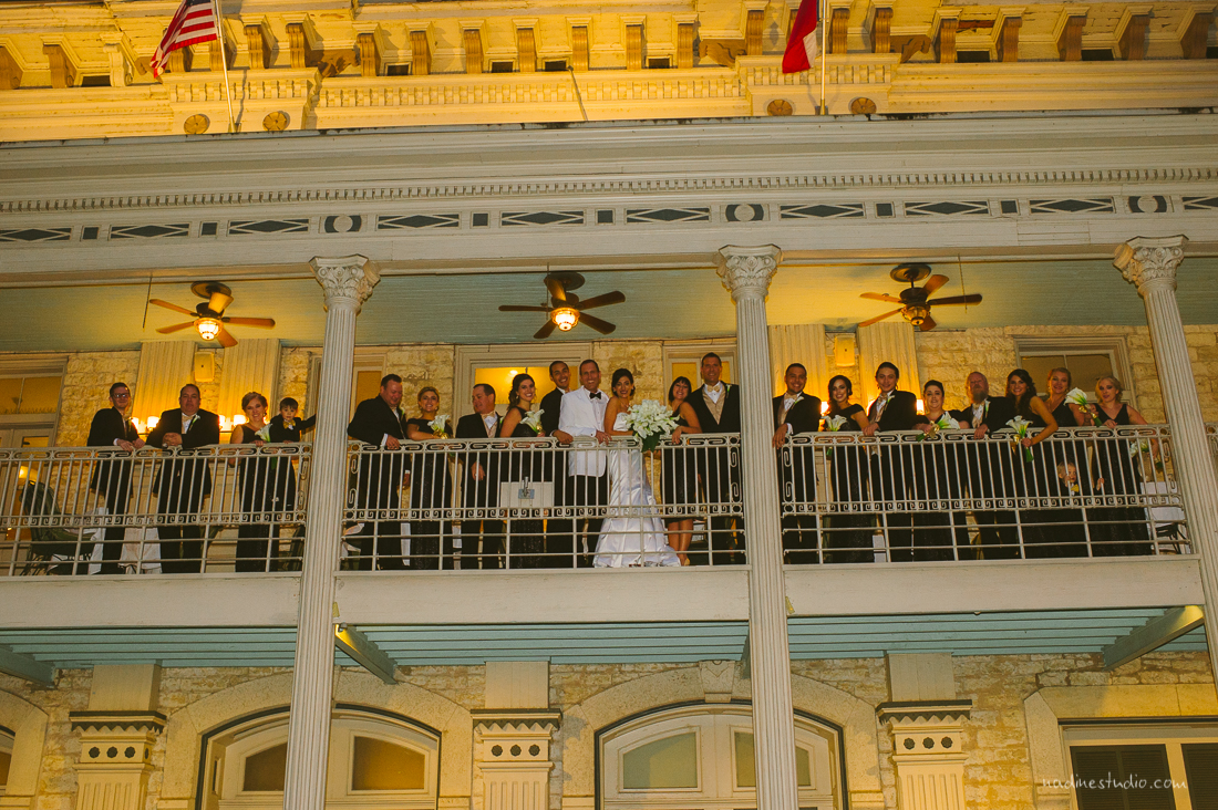 bridal party and groomsmen at the balcony of the austin club