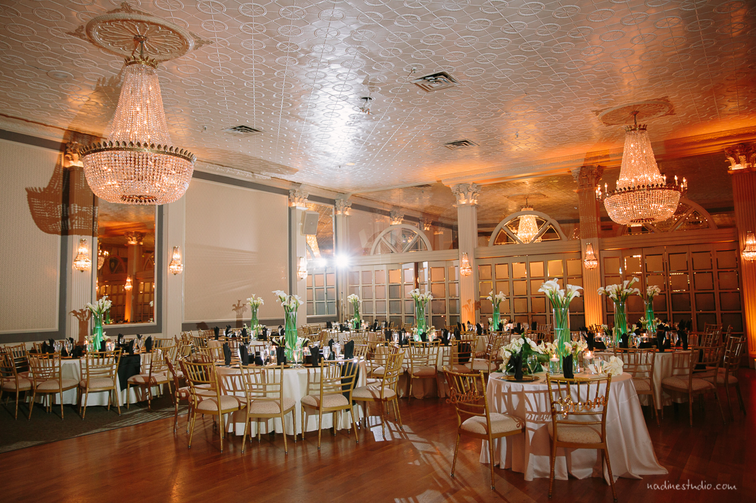 well lit reception ballroom white tablecloth