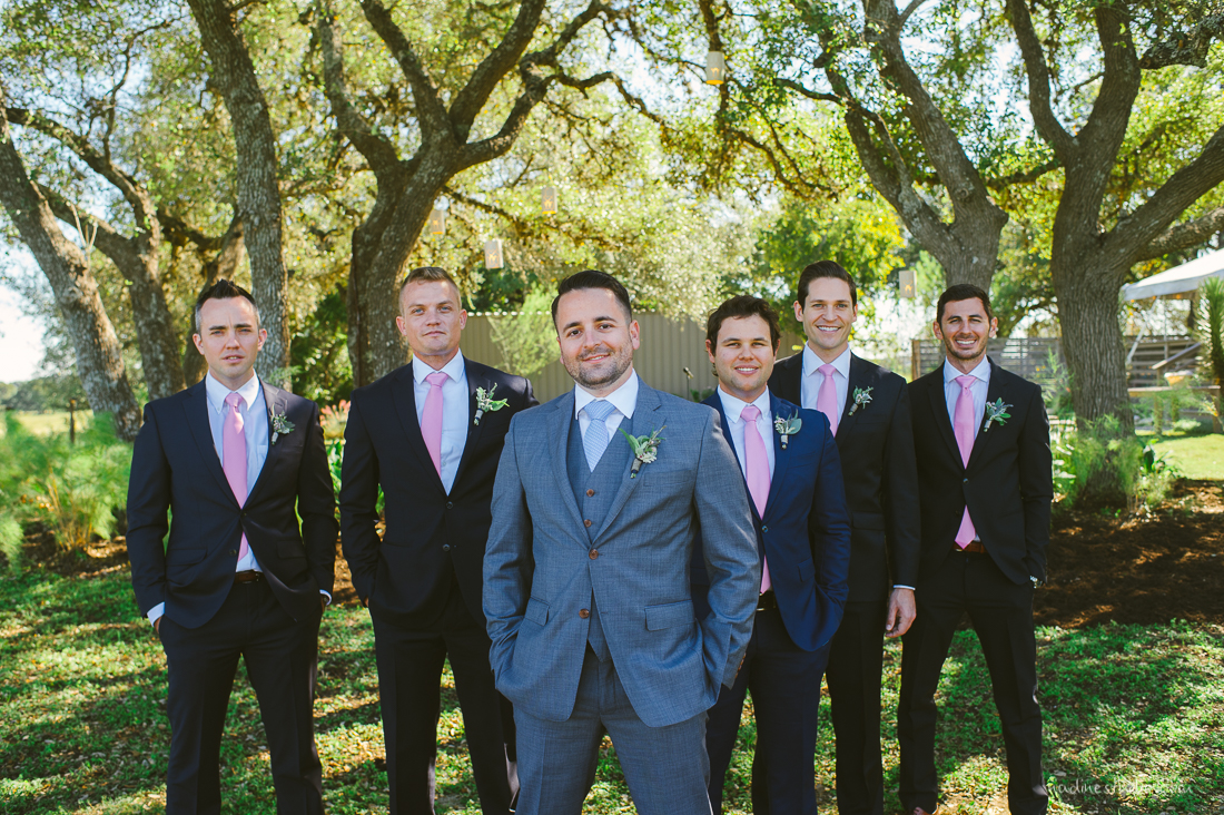 groomsmen and groom in gray