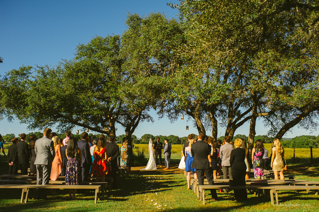 ceremony under a giant oak tree at stonehouse villa