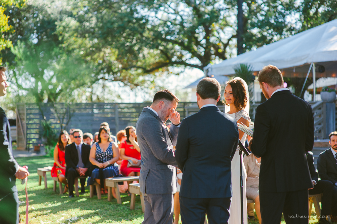 groom tearing up at wedding ceremony