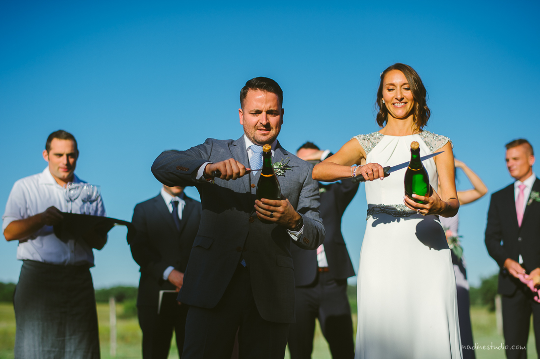 bride and groom sabering champagne