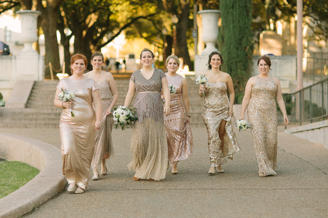 bridesmaids in gold walking down the UT quad for UT bridesmaids pictures