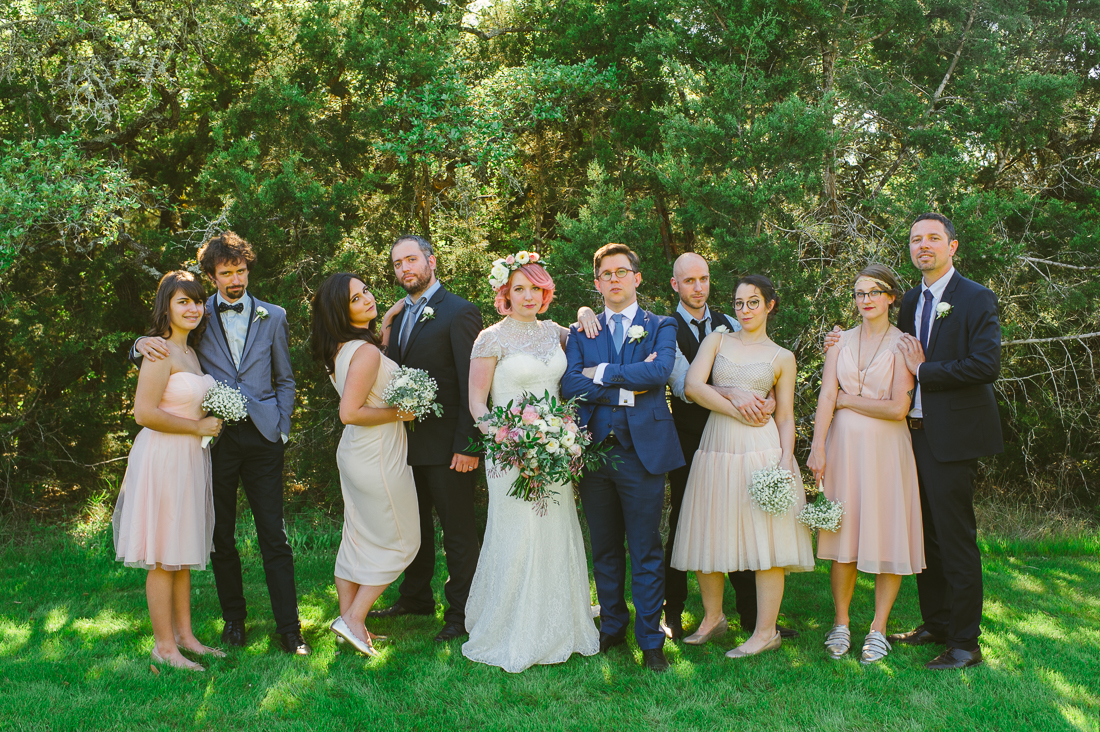 pink and blue suit bridal party