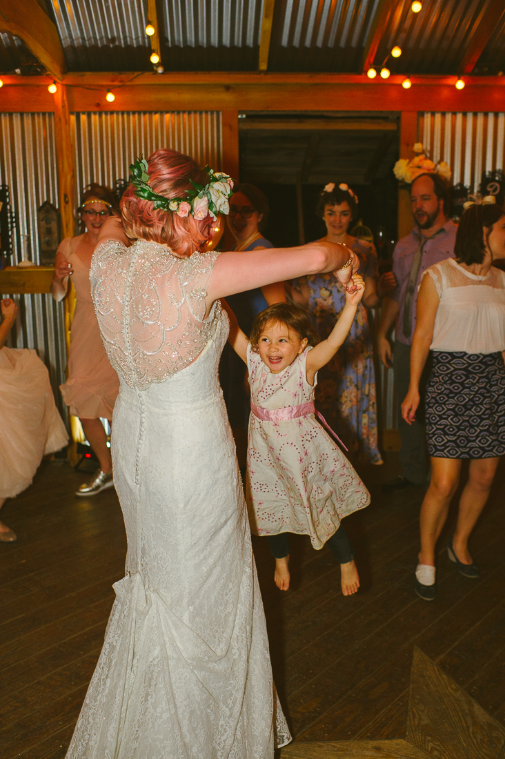 bride dancing with toddler