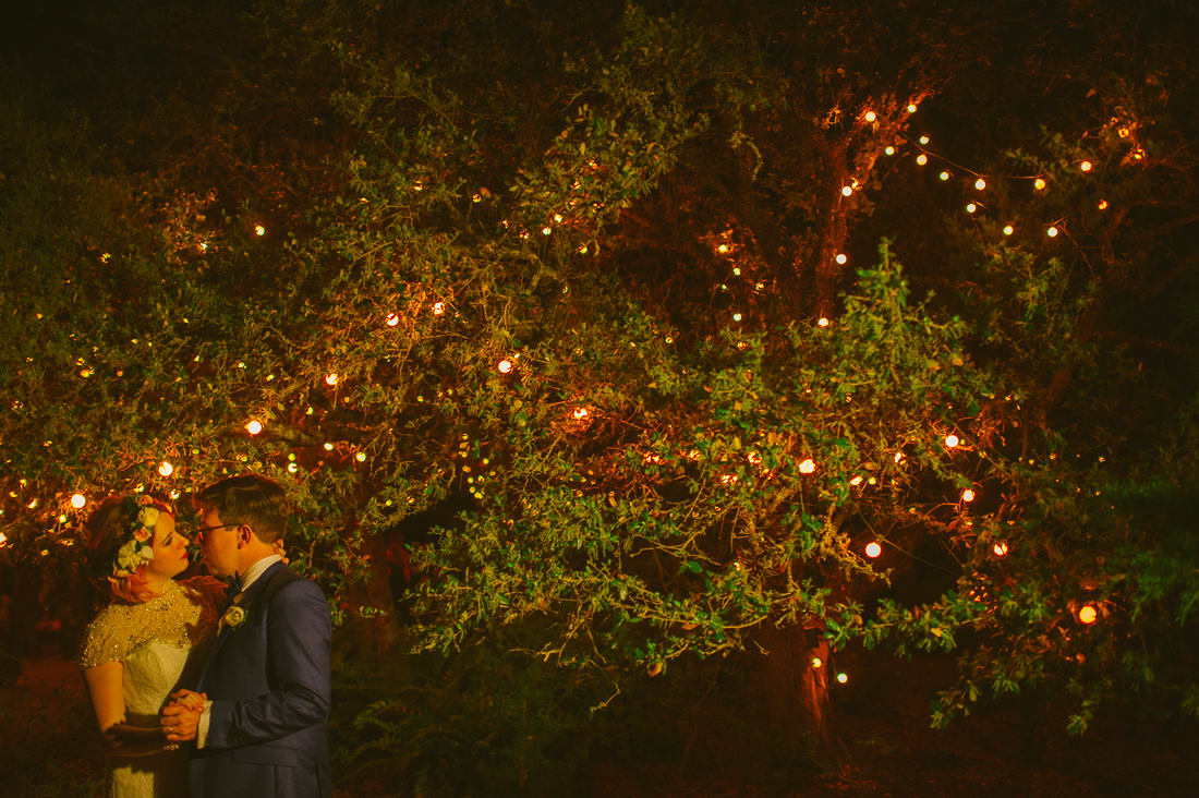 bride and groom in twinkle lights