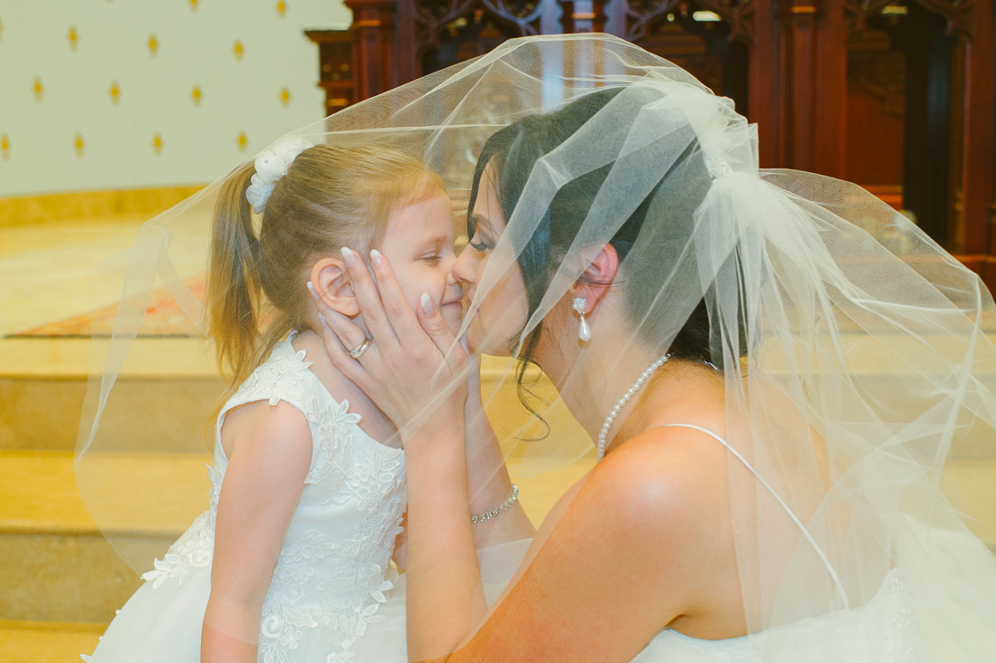 bride and flower girl at st louis king of france catholic church